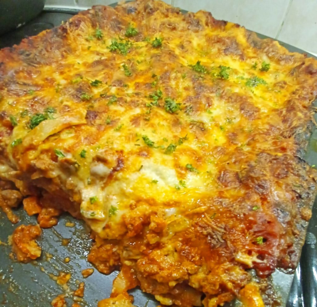 lasagne in pan with slice missing